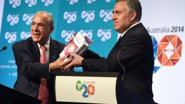 Former Treasurer Joe Hockey with OECD secretary-general Angel Gurria at the G20 Finance Ministers and Central Bank Governors Meeting in Cairns in 2014 when the OECD plan to stop multinational tax evasion was discussed.