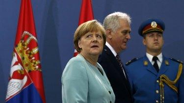 Under pressure: German Chancellor Angela Merkel, left, in Belgrade on Thursday.