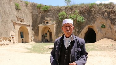 Hai Zhengjun, 64, in front of his former cave dwelling. The land where Hai and his family live has an average annual rainfall of 300-500 millimetres.