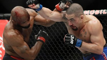True blue: Australian Robert Whittaker won the UFC interim middleweight title with a unanimous points win against Cuban Yoel Romero in Las Vegas.