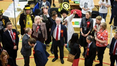 Labour Leader Jeremy Corbyn waves as he arrives at the Sobell Leisure Centre during the Islington and Finsbury counts on Thursday night.