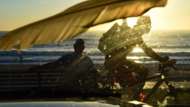 A warm dawn brought plenty of surfers and swimmers out on the Northern Beaches.