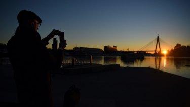 The sun rises over Rozelle Bay on Thursday.
