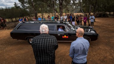 The hearse arrives at the ceremonial site in Wagga Wagga.