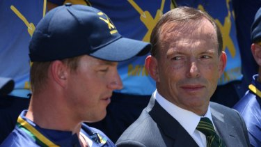 Prime Minister Tony Abbott, pictured at the PM's XI in Canberra on Wednesday, has defended his government's decision to cut the rebate.