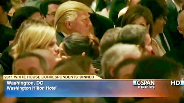 Butt of jokes: Donald Trump (centre left) listens at the 2011 White House Correspondents' Association dinner.