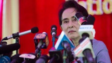 Nobel Laureate Aung San Suu Kyi addresses the media at her home in Yangon, Myanmar on Thursday.