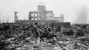 An Allied correspondent stands in the rubble of a building that once was a movie theatre in Hiroshima, on Sepember 8, 1945, two days after the first nuclear weapon ever used in warfare was dropped by the US.