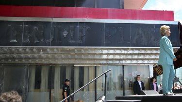 Hillary Clinton stands near the faded sign of the Trump Plaza, at a rally in Atlantic City, New Jersey, last month.