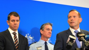 Prime Minister Tony Abbott, right, with NSW Premier Mike Baird and NSW Police Commissioner Andrew Scipione.
