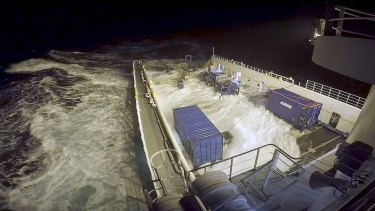 The Go Phoenix being battered by large waves during the search for missing MH370 in the southern Indian Ocean.