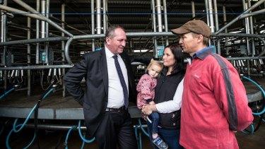 Barnaby Joyce talks with dairy farmer Ashley Galt and his wife Lucy Galt.