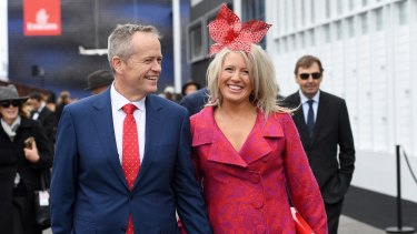 Trackside pitstop: Bill and Chloe Shorten in the Birdcage on Melbourne Cup Day.