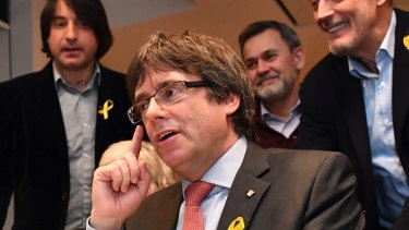 Ousted Catalan leader Carles Puigdemont gestures as he watches the election results in Brussels.