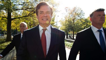 Paul Manafort, accompanied by his lawyers, arrives at federal court in Washington on November 2.