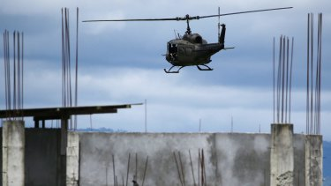 A military helicopter prepares to land as fighting continues in Marawi on Friday.