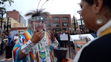 Robert Ironshield Jr is blessed by Kumai Yaqui Chicana during a rally to show solidarity with the Standing Rock Sioux in Boulder, Colorado.