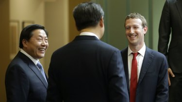 Chinese President Xi Jinping, centre, talks with Facebook CEO Mark Zuckerberg, right, as Lu Wei, left, China's internet czar at the Microsoft Redmond campus in 2015.