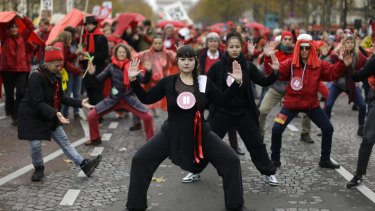 Climate activists perform during a  demonstration in Paris.