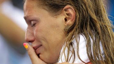 Russia's Yulia Efimova cries after placing second in the women's 100m breaststroke final.