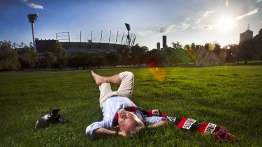Andy May enjoys the last rays of light in Yarra Park with the famous MCG in the background.