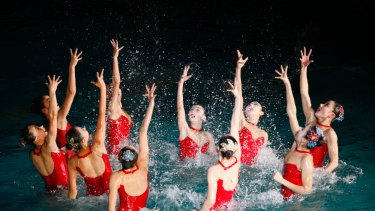 North Koreans perform to celebrate the birth anniversary of late leader Kim Jong Il at the swimming pool of the Changgwang Health Complex in Pyongyang, North Korea.