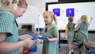 Kindergarden students from Camdenville Public School use some of the technology of the classroom of the future at a media event in Eveleigh. L-R are Isla  Bridges-Dodd, Sian Gill, Matilda Harris, and Charlize Dunn.