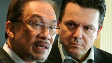 Then Malaysian opposition leader Anwar Ibrahim, left, with Australian senator Nick Xenophon in Jakarta.
