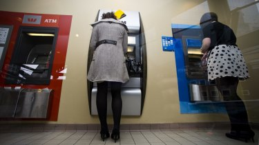 ATM withdrawals are dropping as consumers use cash less frequently.