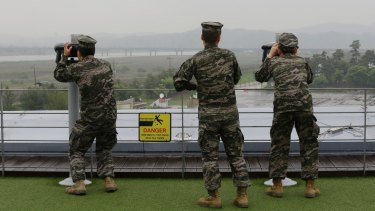 South Korean marines look toward North Korea through binoculars at the Imjingak Pavilion near the border village of Panmunjom earlier this month.