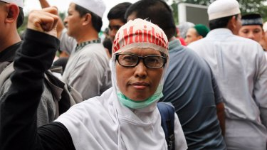 A protester outside Istiqlal Mosque in Jakarta on Friday afternoon.