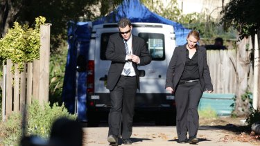 Detectives outside the Lin family's North Epping home after the five bodies were discovered