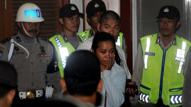 Andrew Chan's girlfriend Febyanti Herewila and brother Michael Chan moments after Indonesian police refused their request to see Chan before his transfer.
