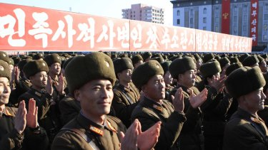 North Korean military personnel clap hands in a rally, after North Korea said it had conducted a hydrogen bomb test earlier this month.