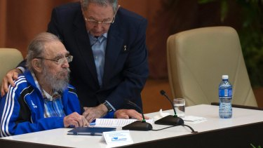 Cuba's President Raul Castro, right, embraces his brother Fidel at the 7th Cuban Communist Party Congress in Havana,  2016.