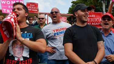 Supporters of Donald Trump yell at reporters during a campaign rally in Miami.