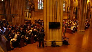 Sydneysiders attended a mass to pay respect to the victims of the Martin Place siege on Tuesday in St Marys Cathedral.