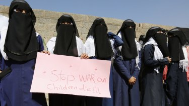 Yemeni women hold a banner as they take part in a protest marking International Women's Day in front of the UN building in Sanaa, Yemen, on March 8.