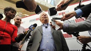 University of Chicago professor Richard Thaler talks with the media after winning the Nobel prize for economics.