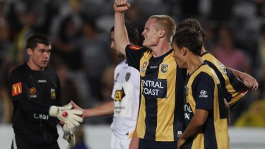 Matt Simon celebrates a victory with the Central Coast Mariners.