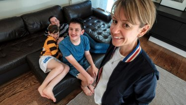 Kerry Moore with sons (from left) James, 10, Henry (obscured), 13, and Oliver, 15.