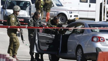 Israeli security forces at the checkpoint between the city of Ramallah and Jewish settlement of Beit El in the West Bank on Sunday after a Palestinian identified as Amjad Sukkari  allegedly wounded three people before being shot by Israeli military officers.