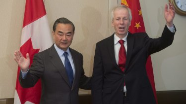 Wang Yi, left, and Canada's Minister of Foreign Affairs Stephane Dion pose for photographers on Wednesday.