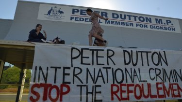 Protesters who climbed onto the awning of Immigration Minister Peter Dutton's office have been fined.