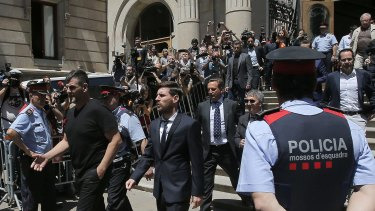 Messi leaves a Barcelona court in June.