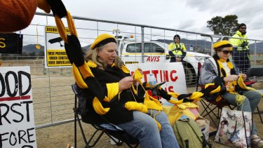 NCH NEWS. Protesters blockaded access to AGL's Waukivory Pilot Project exploratory coal seam gas fracking site on Fairbairn Road, Gloucester. Pic shows Manning Valley residents Kathy Barbour and Jennifer Granger knitting a chain in front of the gates to the site. 16th August 2014.