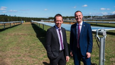 Ministers Shane Rattenbury and Andrew Barr at the Mugga lane solar farm in October 2016.