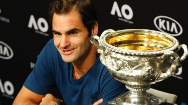 He's been here before: Federer talks to the media after winning the Australian Open on Sunday.
