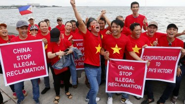 Vietnamese expatriates cheer at a rally by the Manila's baywalk before the Hague-based UN international arbitration tribunal announced its ruling on South China Sea.