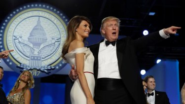 President Donald Trump acknowledges the crowd with first lady Melania Trump at the Freedom Ball.